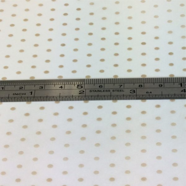 2mm Gold Spot On White Tissue Paper With Metal Ruler Showing Dainty Spots