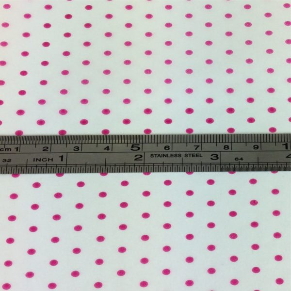 2mm Pink Spot On White Tissue Paper With Metal Ruler Showing Dainty Spot