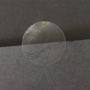 Clear 25mm Diameter Circle Sticker - Sticker Visible On Black Card Close Up